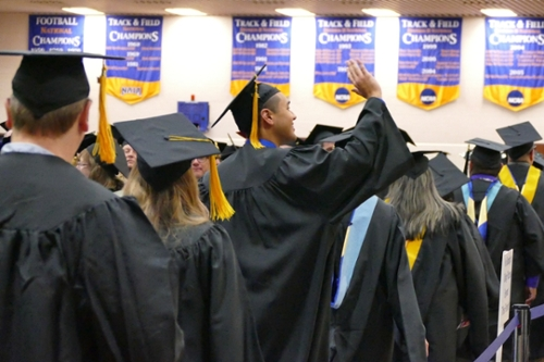 Graduate waves to family member