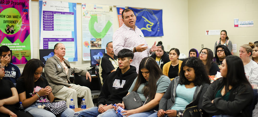 Sergio Tinoco speaks to students at H.M. King High School.
